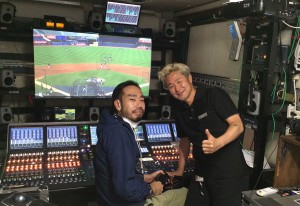 Kazutaka Noda (right) and the show's A1 inside the audio production trailer